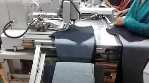 What is the automatic J Stitch machine?